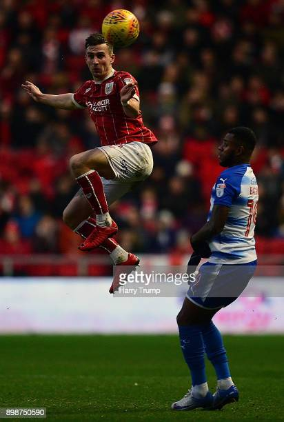 Joe Bryan of Bristol City wins the aerial ball ahead of Leandro Bacuna of Reading during the Sky Bet Championship match between Bristol City and...