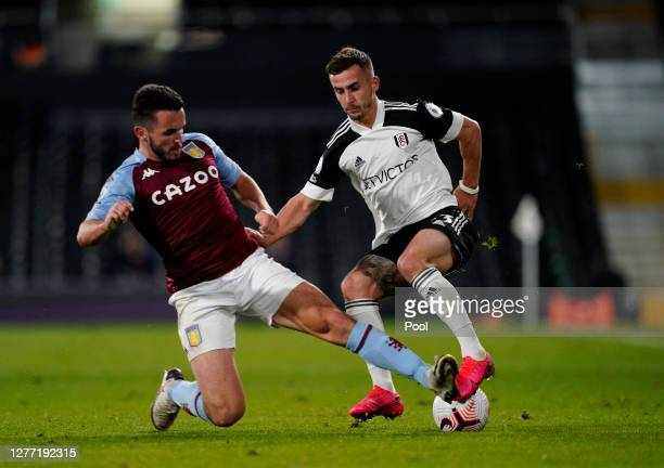 Joe Bryan of Fulham battles for possession with John McGinn of Aston Villa during the Premier League match between Fulham and Aston Villa at Craven...
