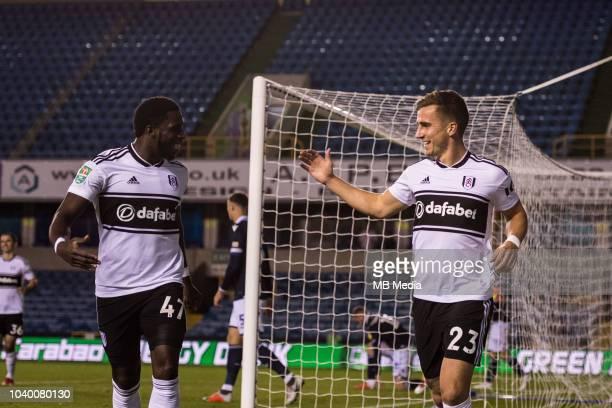 Joe Bryan of Fulham celebrates with team mate Aboubakar Kamara after scoring his team's first goal during the Carabao Cup Third Round match between...