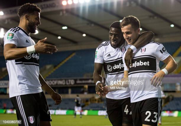 Joe Bryan of Fulham celebrates with team mates Aboubakar Kamara and Cyrus Christie after scoring his team's first goal during the Carabao Cup Third...