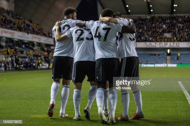 Joe Bryan of Fulham celebrates with team mates after scoring a goal during the Carabao Cup Third Round match between Millwall and Fulham at The Den...