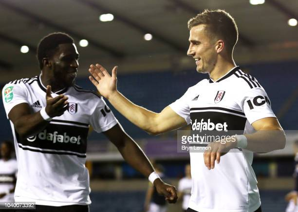 Joe Bryan of Fulham celebrates with teammate Aboubakar Kamara after scoring his team's first goal during the Carabao Cup Third Round match between...