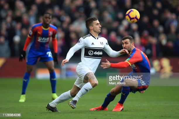 Joe Bryan of Fulham controls the ball while under pressure from James McArthur of Crystal Palace during the Premier League match between Crystal...