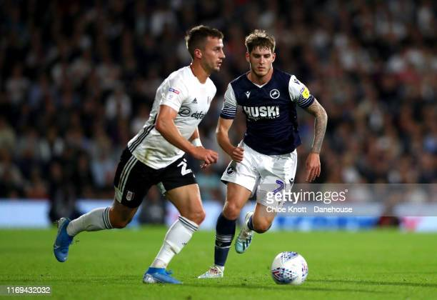 Joe Bryan of Fulham FC and Connor Mahoney of Millwall FC in action during the Sky Bet Championship match between Fulham and Millwall at Craven...