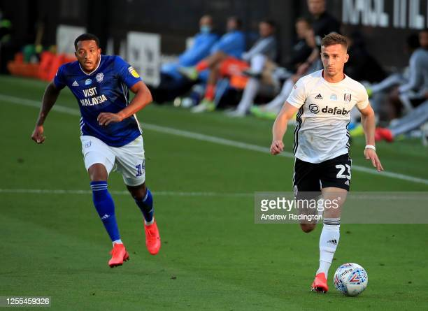Joe Bryan of Fulham goes past Nathaniel MendezLaing of Cardiff City during the Sky Bet Championship match between Fulham and Cardiff City at Craven...