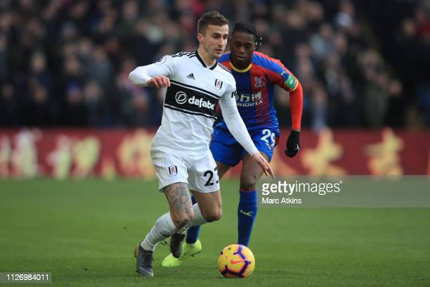 Joe Bryan of Fulham in action with Aaron WanBissaka of Crystal Palace during the Premier League match between Crystal Palace and Fulham FC at...