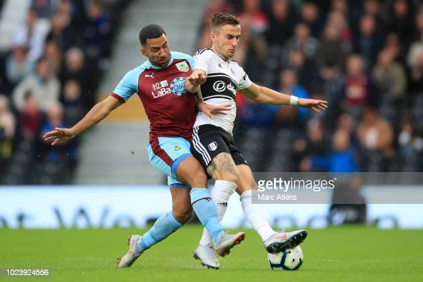 Joe Bryan of Fulham is challenged by Aaron Lennon of Burnley during the Premier League match between Fulham FC and Burnley FC at Craven Cottage on...