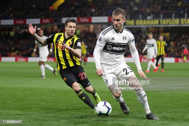 Joe Bryan of Fulham is challenged by Kiko Femenia of Watford during the Premier League match between Watford FC and Fulham FC at Vicarage Road on...