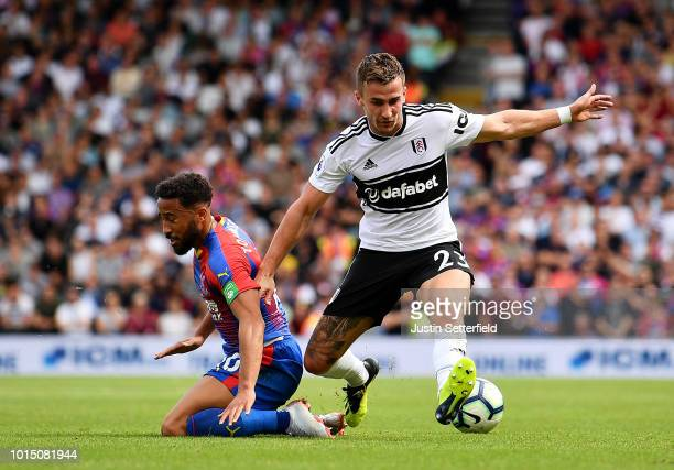 Joe Bryan of Fulham is tackled by Andros Townsend of Crystal Palace during the Premier League match between Fulham FC and Crystal Palace at Craven...
