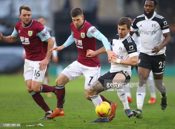 Joe Bryan of Fulham looks to break past Dale Stephens and Johann Gudmundsson of Burnley during The Emirates FA Cup Fourth Round match between Fulham...