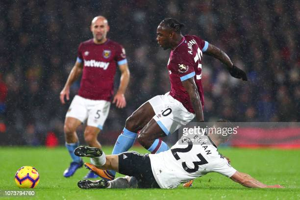 Joe Bryan of Fulham tackles Michail Antonio of West Ham United during the Premier League match between Fulham FC and West Ham United at Craven...