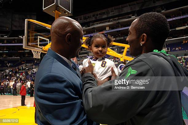 Joe Bryant Interim Head Coach of the Los Angeles Sparks with son Kobe Bryant of the Los Angeles Lakers and granddaughter Natalia stand after the game...