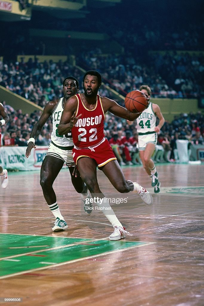 Joe Bryant #22 of the Houston Rockets drives to the basket against the Boston Celtics during a game played in 1983 at the Boston Garden in Boston, Massachusetts.