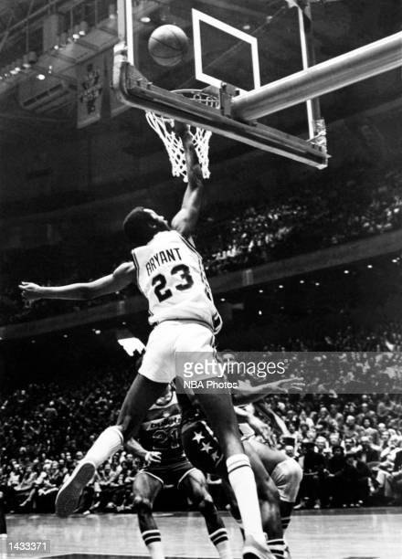 Joe Bryant of the Philadelphia 76'ers goes for a layup against the Washington Bullets during the NBA game at The Philadelphia Civic Auditorium in...