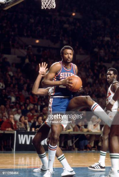 Joe Bryant of the Philadelphia 76ers grabs a rebound against the Milwaukee Bucks during an NBA basketball game circa 1979 at the MECCA Arena in...