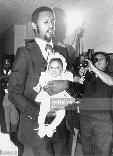 Joe Bryant the Philadelphia 76ers second year forward holds his daughter Shari as he enters a courtroom in Philadelphia where he faces charges of...