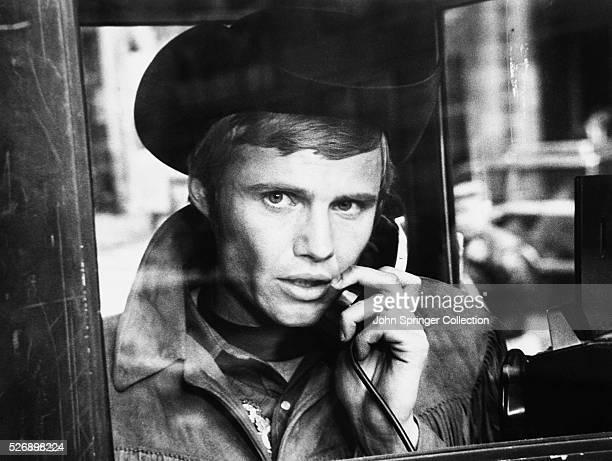 Joe Buck makes a telephone call in Midnight Cowboy