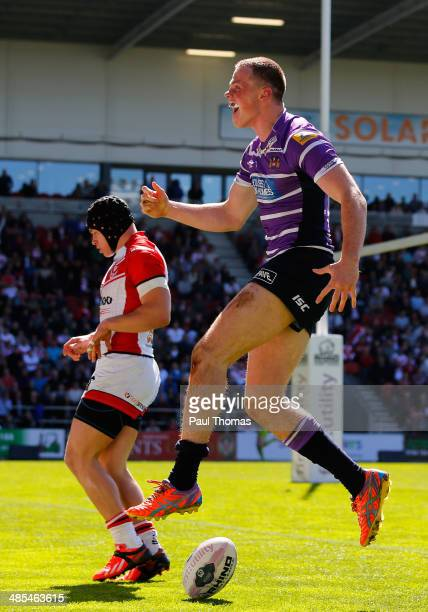 Joe Burgess of Wigan celebrates after scoring a try during the Super League match between St Helens and Wigan Warriors at Langtree Park on April 18,...