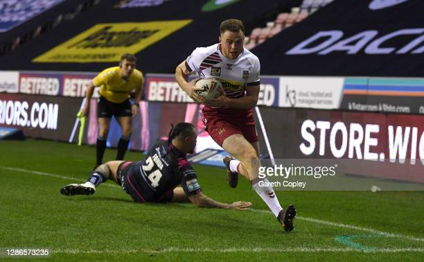 Joe Burgess of Wigan scores his team's opening try during the Betfred Super League Play-Off Semi-Final between Wigan Warriors and Hull FC at DW...