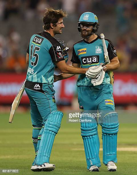 Joe Burns and Alex Ross of the Brisbane Heat celebrate after the HEat defeated the Stars during the Big Bash League match between the Melbourne Stars...