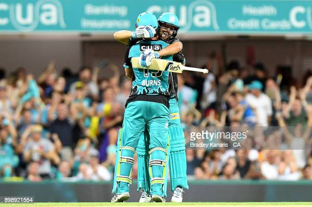 Joe Burns and Alex Ross of the Heat celebrate victory after the Big Bash League match between the Brisbane Heat and the Sydney Thunder at The Gabba...