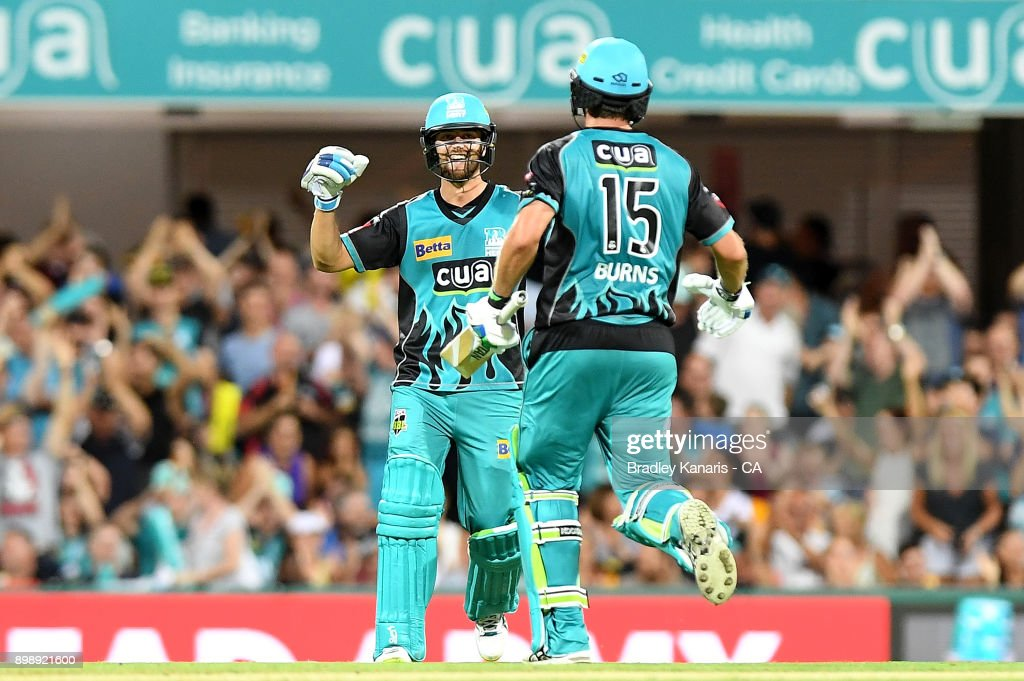 Joe Burns and Alex Ross of the Heat celebrate victory after the Big Bash League match between the Brisbane Heat and the Sydney Thunder at The Gabba on December 27, 2017 in Brisbane, Australia.