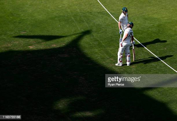 Joe Burns and Marnus Labuschagne of Brad Haddin XII walk out to bat during day one of the Australian Cricket Team Ashes Tour match between Brad...