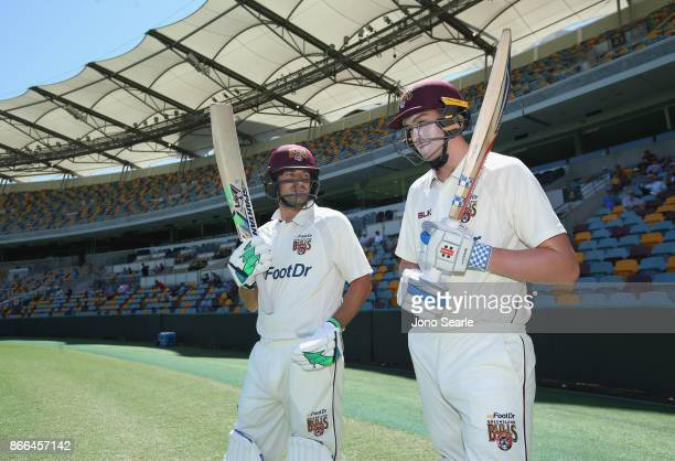 Joe Burns and Matthew Renshaw of QLD during day one of the Sheffield Shield match between Queensland and Victoria at the Gabba on October 26 2017 in...
