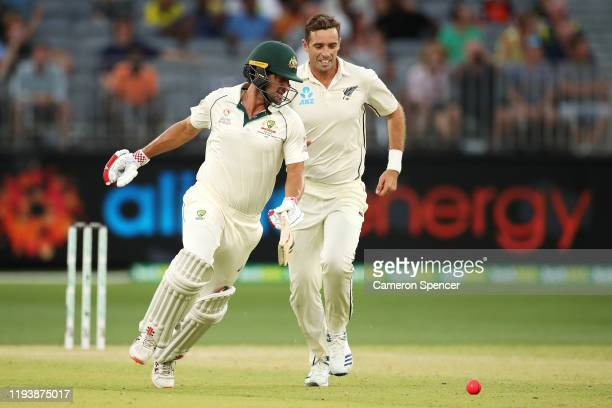 Joe Burns of Australia avoids contact with Tim Southee of New Zealand as he runs between the wickets during day three of the First Test match in the...
