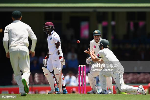 Joe Burns of Australia catches Kemar Roach of West Indies off a delivery by team mate Nathan Lyon of Australia during day five of the third Test...
