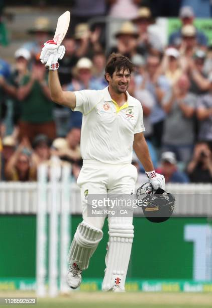 Joe Burns of Australia celebrates and acknowledges the crowd after scoring a century during day one of the Second Test match between Australia and...