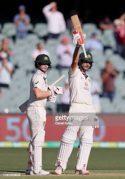 Joe Burns of Australia celebrates hitting a six to make his 50 and win the match during day three of the First Test match between Australia and India...