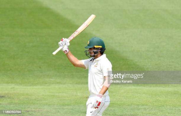 Joe Burns of Australia celebrates scoring a half century during day two of the 1st Domain Test between Australia and Pakistan at The Gabba on...