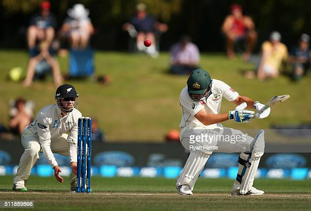 Joe Burns of Australia is hit on the helmet by a delivery from Neil Wagner of New Zealand during day five of the Test match between New Zealand and...