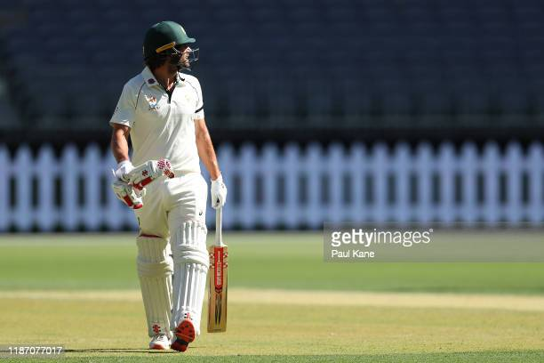 Joe Burns of Australia walks from the field watching replay after being bowled by Imran Khan of Pakistan during day two of the International Tour...