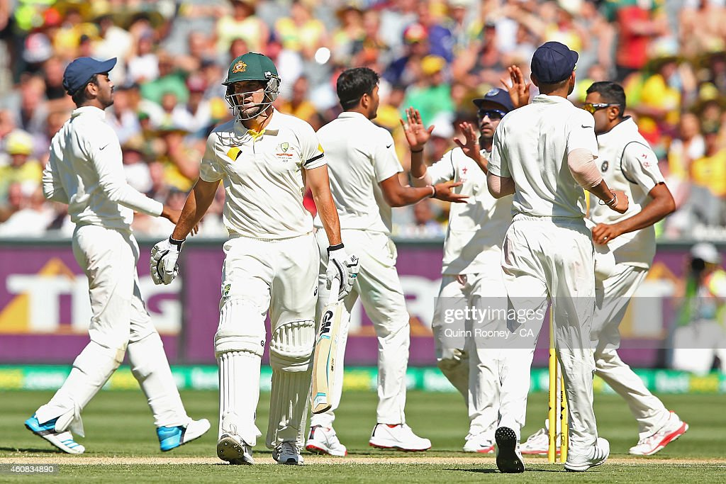 Joe Burns of Australia walks off the field after being dismissed by Umesh Yadav of India during day one of the Third Test match between Australia and India at Melbourne Cricket Ground on December 26, 2014 in Melbourne, Australia.