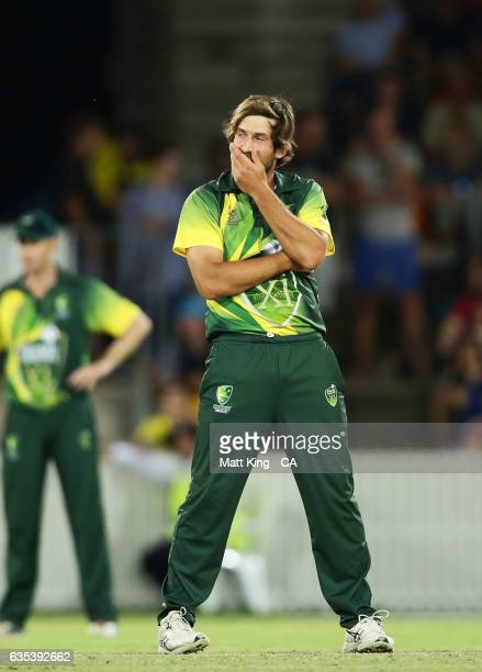 Joe Burns of the Australian PMXI reacts after bowling during the T20 warm up match between the Australian PM's XI and Sri Lanka at Manuka Oval on...