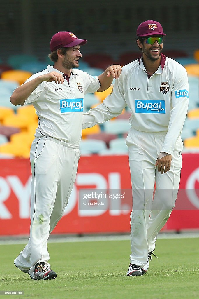 Joe Burns of the Bulls celebrates with team mate Dom Michael after taking a catch to dismiss Ricky Ponting of the Tigers during day one of the Sheffield Shield match between the Queensland Bulls and the Tasmanian Tigers at The Gabba on March 7, 2013 in Brisbane, Australia.