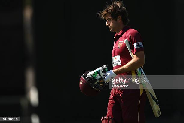 Joe Burns of the Bulls looks dejected after being dismissed during the Matador BBQs One Day Cup match between Queensland and New South Wales at...