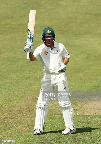 Joe Burns of the CA XI celebrates scoring a century during the tour match between the Cricket Australia XI and New Zealand at Manuka Oval on October...
