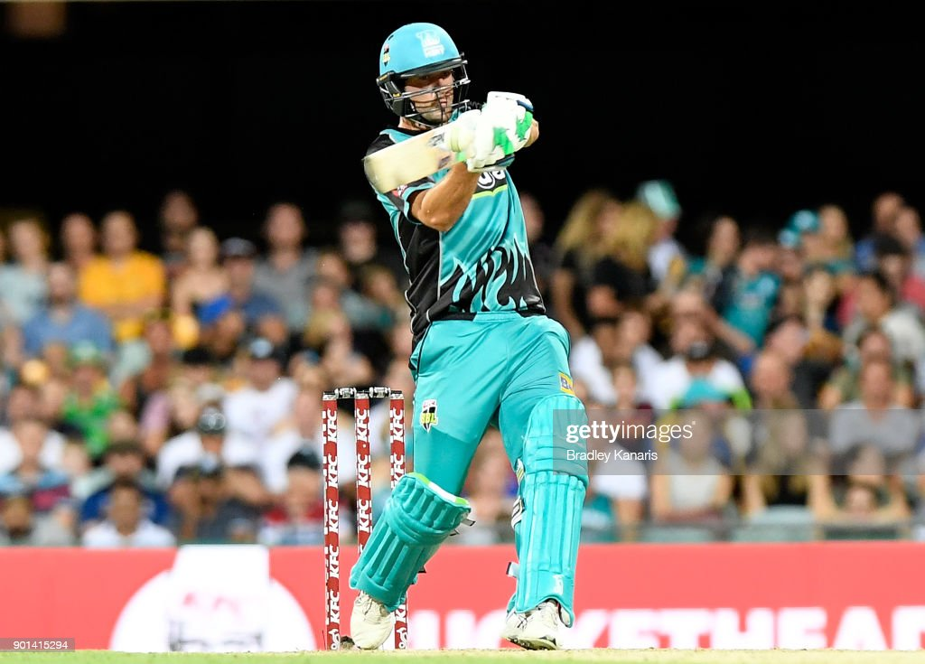 Joe Burns of the Heat hits the ball over the boundary for a six during the Big Bash League match between the Brisbane Heat and the Perth Scorchers at The Gabba on January 5, 2018 in Brisbane, Australia.