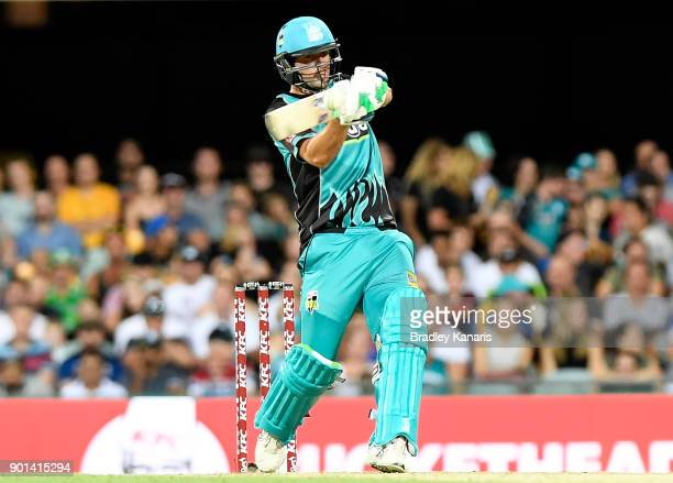 Joe Burns of the Heat hits the ball over the boundary for a six during the Big Bash League match between the Brisbane Heat and the Perth Scorchers at...