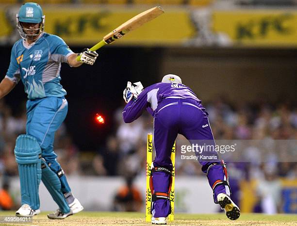 Joe Burns of the Heat is caught short of his ground as he is stumped by Tim Paine of the Hurricanes during the Big Bash League match between Brisbane...