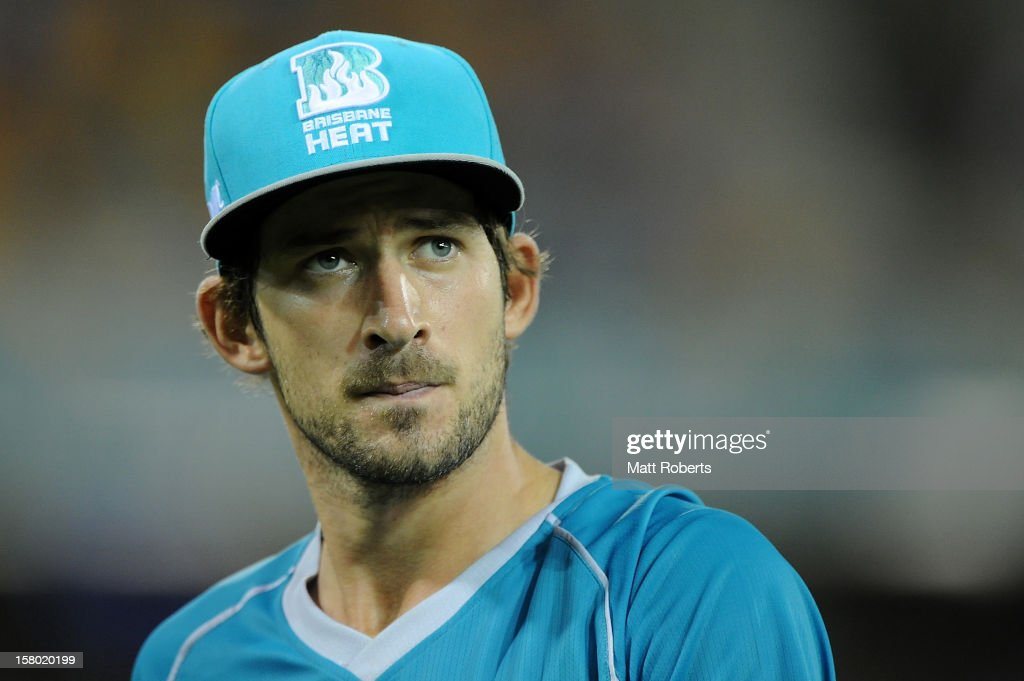 Joe Burns of the Heat looks on during the Big Bash League match between the Brisbane Heat and the Hobart Hurricanes at The Gabba on December 9, 2012 in Brisbane, Australia.