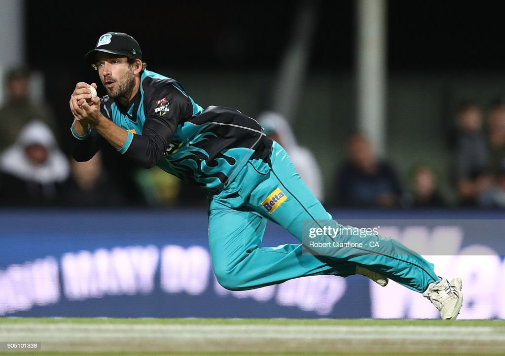 Joe Burns of the Heat takes a catch to dismiss Darcy Short of the Hurricanes during the Big Bash League match between the Hobart Hurricanes and the Brisbane Heat at Blundstone Arena on January 15, 2018 in Hobart, Australia.