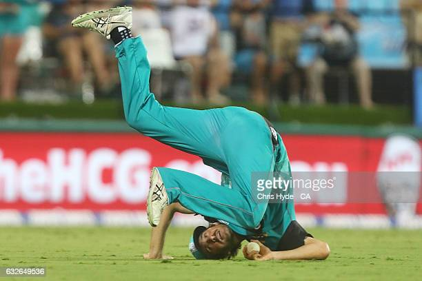 Joe Burns of the Heat takes a catch to dismiss Moises Henriques of the Sixers during the Big Bash League semi final match between the Brisbane Heat...