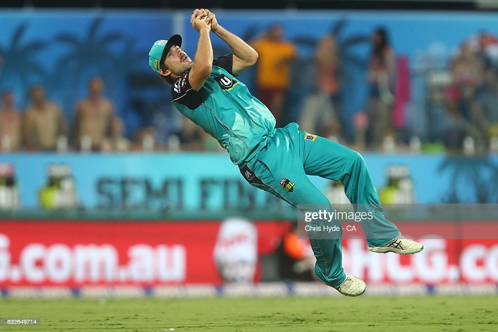 Joe Burns of the Heat takes a catch to dismiss Moises Henriques of the Sixers during the Big Bash League semi final match between the Brisbane Heat and the Sydney Sixers at the The Gabba on January 25, 2017 in Brisbane, Australia.