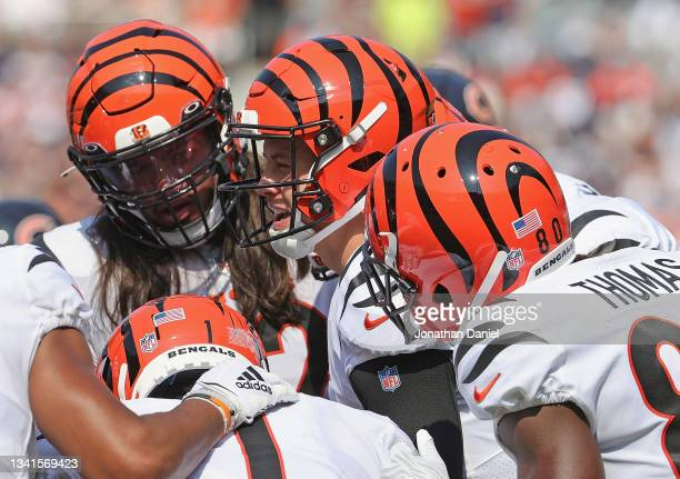 Joe Burrow of the Cincinnati Bengals calls a play in the huddle against the Chicago Bears at Soldier Field on September 19, 2021 in Chicago,...