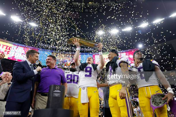 Joe Burrow of the LSU Tigers and Grant Delpit of the LSU Tigers celebrate with the trophy after defeating the Clemson Tigers 4225 in the College...