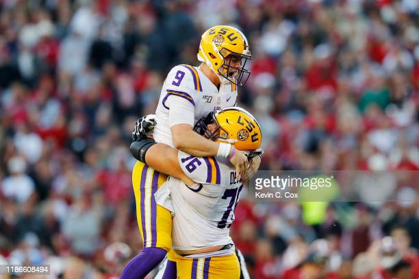 Joe Burrow of the LSU Tigers celebrates after throwing a 13yard touchdown pass during the second quarter against the Alabama Crimson Tide in the game...